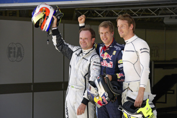 Top 3 fastest in qualifying: Rubens Barrichello, 2nd position, pole sitter Sebastian Vettel, and Jenson Button, 3rd position.
