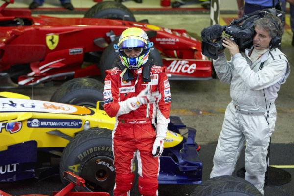 Felipe Massa celebrates a proud victory, despite losing the championship on the last lap.