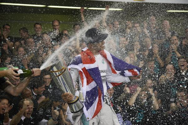 Lewis Hamilton is sprayed.