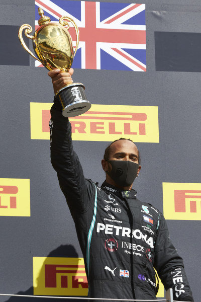 Lewis Hamilton, Mercedes-AMG Petronas F1, celebrates on the podium and holds his trophy