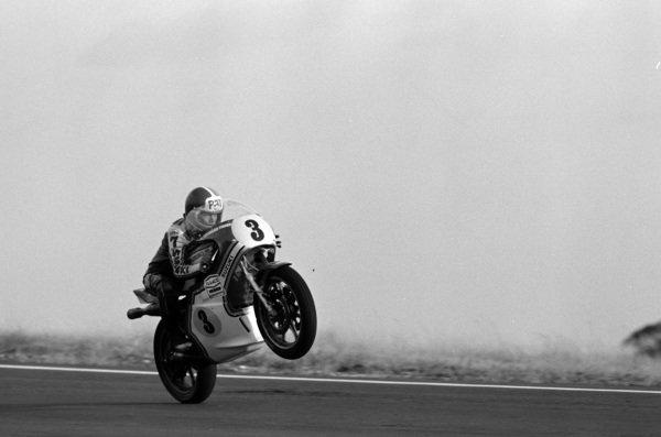 Pat Hennen wheelies his Suzuki.