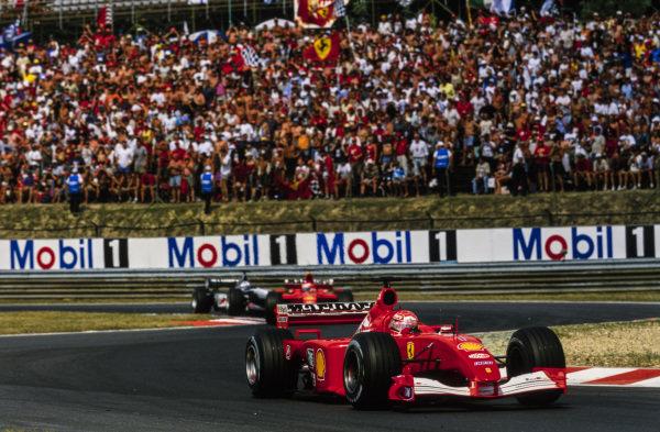 Michael Schumacher, Ferrari F2001, leads Rubens Barrichello, Ferrari F2001, and David Coulthard, McLaren MP4-16 Mercedes.