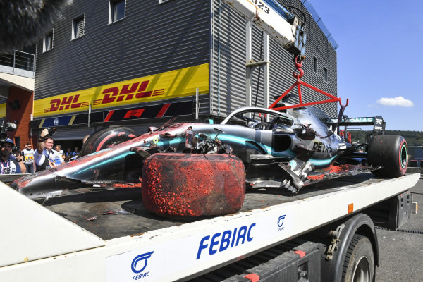 The damaged Lewis Hamilton Mercedes AMG F1 W10 returns to the pits on a the back of a truck in FP3