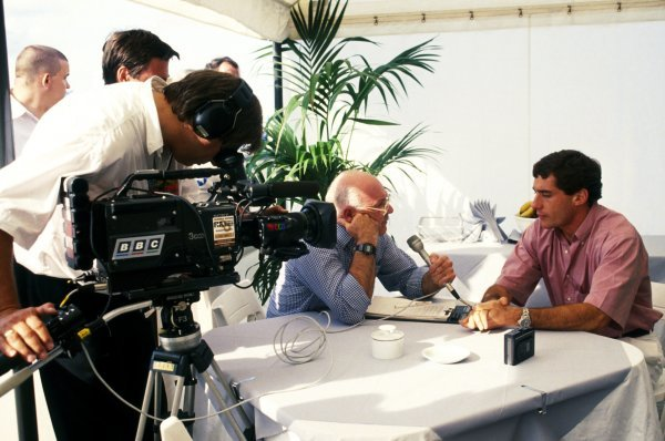 Ayrton Senna (BRA) McLaren (Right), who crashed out on the opening lap of the race, is interviewed by Murray Walker (GBR) (Centre) Television Commentator for the BBC. French Grand Prix, Rd 8, Magny-Cours, France, 5 July 1992.