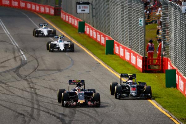 Albert Park, Melbourne, Australia. Sunday 20 March 2016. Carlos Sainz Jr, Toro Rosso STR11 Ferrari, leads Jenson Button, McLaren MP4-31 Honda. World Copyright: Andy Hone/LAT Photographic ref: Digital Image _ONZ4231