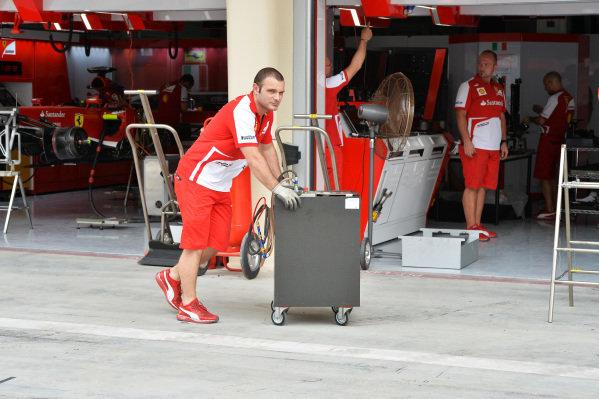 Ferrari mechanic with fuel bowser. Formula One World Championship, Rd4, Bahrain Grand Prix Preparations, Bahrain International Circuit, Sakhir, Bahrain, Thursday 18 April 2013.