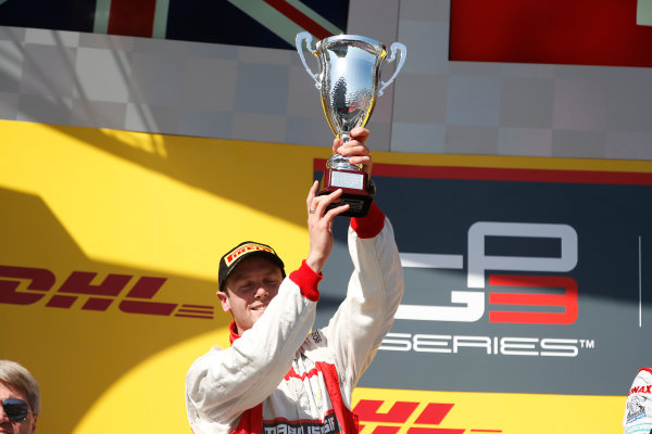 2014 GP3 Series. Round 8.   Sochi Autodrom, Sochi, Russia. Sunday Race 2 Sunday 12 October 2014. Dean Stoneman (GBR, Marussia Manor Racing) on the podium. Photo: Glenn Dunbar/GP3 Series Media Service. ref: Digital Image _89P2989