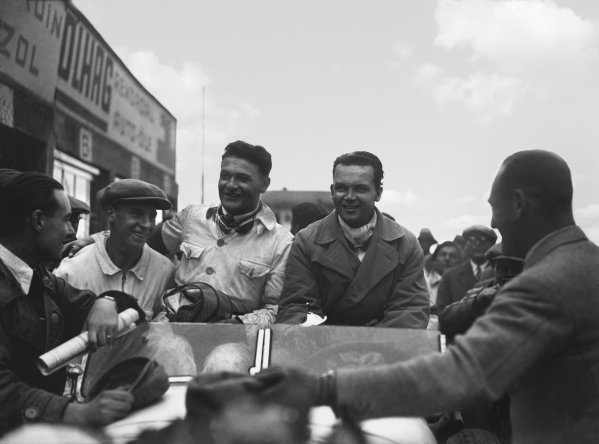 Nurburgring, Germany. 19th July 1931. Rudolf Caracciola (Mercedes-Benz SSKL) and his mechanic,Wilhelm Sebastian, celebrate 1st position in the pits, portrait.  World Copyright: LAT Photographic. Ref:  Autocar Glass Plate B6839.
