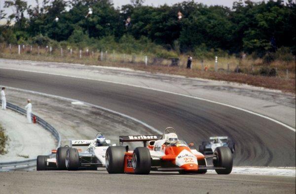 1982 Swiss Grand Prix.Dijon-Prenois, France. 29 August 1982.Andrea de Cesaris, Alfa Romeo 182, 10th position, leads Keke Rosberg, Williams FW08-Ford, 1st position, John Watson, McLaren MP4/1B-Ford, 13th position, and Derek Daly, Williams FW08-Ford, 9th position, action.World Copyright: LAT PhotographicRef: 35mm transparency 82SWI22
