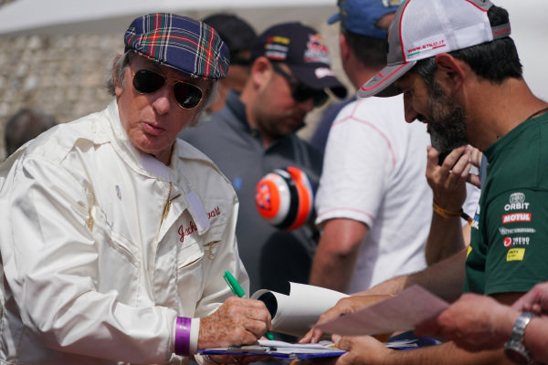 Jackie Stewart signs autographs.