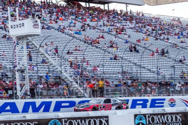 #20: Christopher Bell, Joe Gibbs Racing, Toyota Supra Rheem-Watts checkered flag