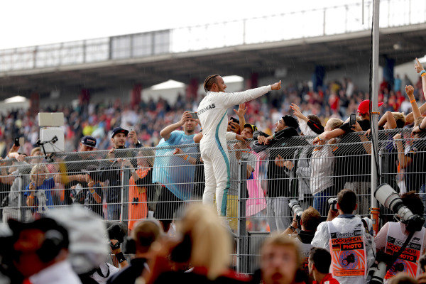 Lewis Hamilton, Mercedes AMG F1, celebrates victory with fans.