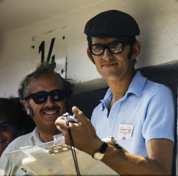 Colin Chapman and Peter Warr on the pit wall.