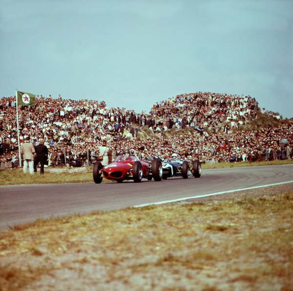 1961 Dutch Grand Prix.Zandvoort, Holland.20-22 May 1961.Richie Ginther (Ferrari Dino 156) leads Stirling Moss (Lotus 18 Climax). They finished in 5th and 4th positions respectively.Ref-3/0274.World Copyright - LAT Photographic