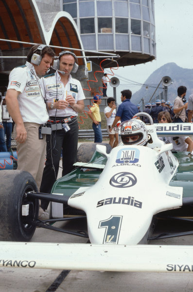 1981 Brazilian Grand Prix.Jacarepagua, Rio de Janeiro, Brazil.27-29 March 1981.Williams team boss Frank Williams and Patrick Head overlook their driver Alan Jones (Williams FW07C Ford).Ref-81 BRA 02.World Copyright - LAT Photographic