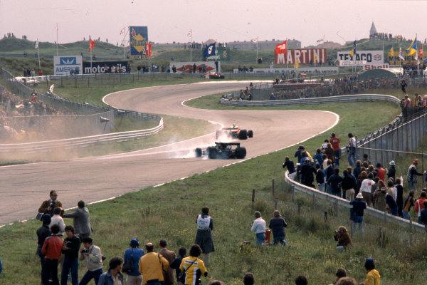 1977 Dutch Grand Prix.Zandvoort, Holland.26-28 August 1977.James Hunt (McLaren M26 Ford) and Mario Andretti (Lotus 78 Ford) have a collision on lap 5.Ref-77 HOL 14.World Copyright - LAT Photographic
