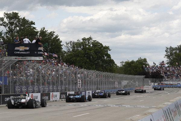 Scott Dixon, Chip Ganassi Racing Honda leads a restart as Ken Kelzer of GM waves the green flag