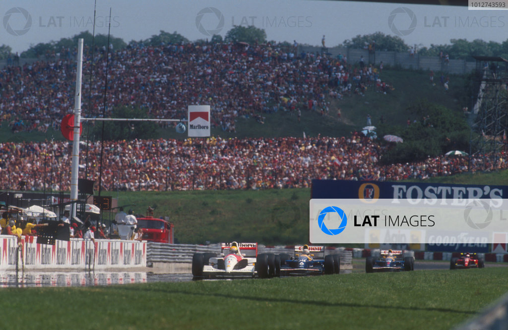 1991 Hungarian Grand Prix. Hungaroring, Budapest, Hungary 9-11 August 1991 Ayrton Senna (McLaren MP4/6 Honda) leads Riccardo Patrese and Nigel Mansell, (both Williams FW14 Renault's) ahead of Alain Prost (Ferrari 643). Ref-91 HUN 02 World Copyright - LAT Photographic