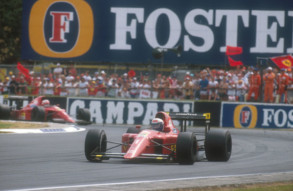 1990 British Grand Prix.Silverstone, England.13-15 July 1990.Alain Prost followed by teammate Nigel Mansell (both Ferrari 641's). Prost won the race, but Mansell exited onnlap 55 with a gearbox failure.Ref-90 GB 17.World Copyright - LAT Photographic