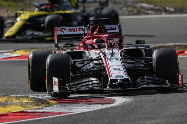 Kimi Raikkonen, Alfa Romeo Racing C39, leads Esteban Ocon, Renault R.S.20