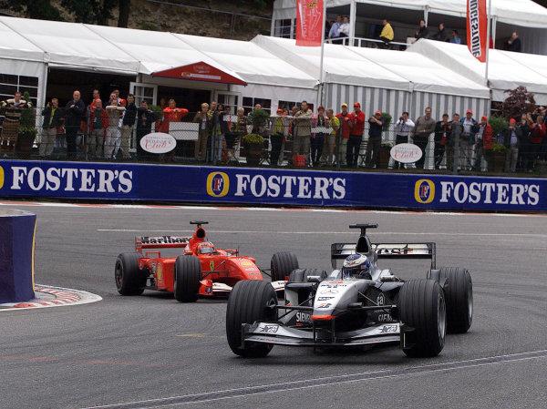 2001 Belgian Grand Prix - RaceSpa Francorchamps, Belgium. 2nd Spetember 2001.Mika Hakkinen, West McLaren Mercedes MP4/16, leads Rubens Barrichello, Ferrari F2001, action.World Copyright: Steve Etherington/LAT Photographicref: 17 5mb Digital Image Only