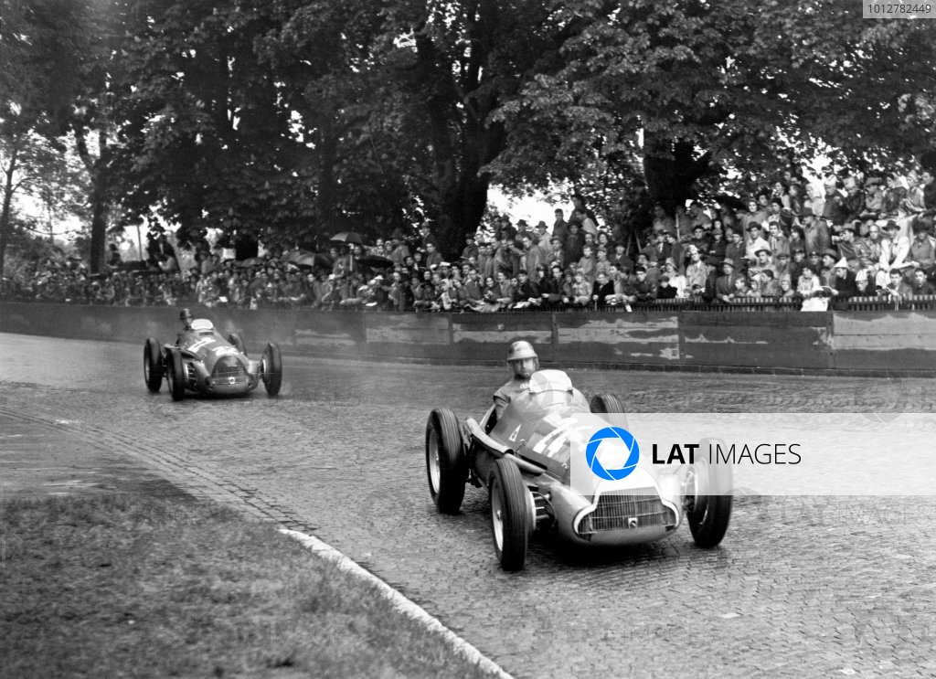 1951 Swiss Grand PrixBremgarten, Switzerland. 1951.Race winner (1st), Juan Manuel Fangio, (Alfa Romeo 159A 8), action.World Copyright: LAT Photographic. ref: Autocar Glass Plate C29190