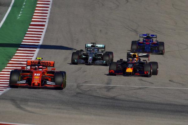 Charles Leclerc, Ferrari SF90, leads Max Verstappen, Red Bull Racing RB15, Lewis Hamilton, Mercedes AMG F1 W10, and Daniil Kvyat, Toro Rosso STR14