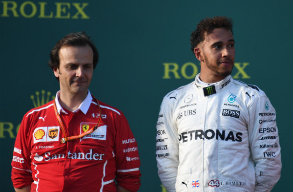 Luigi Fraboni (ITA) Ferrari Head of Engine Trackside Operations and Lewis Hamilton (GBR) Mercedes AMG F1 on the podium at Formula One World Championship, Rd1, Australian Grand Prix, Race, Albert Park, Melbourne, Australia, Sunday 26 March 2017.