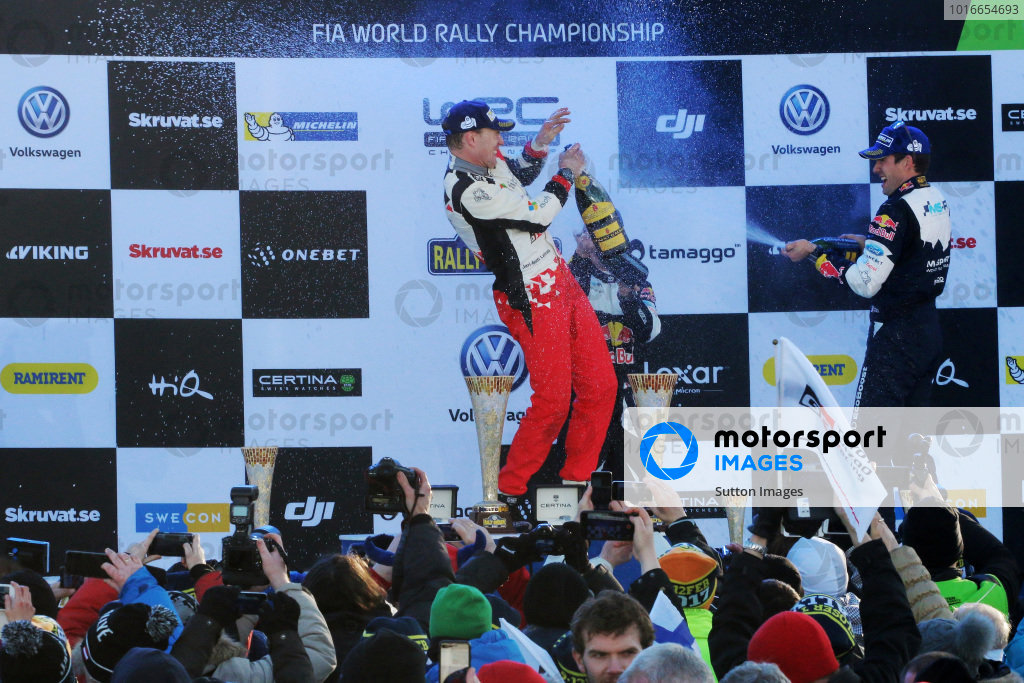 Rally winner Jari-Matti Latvala (FIN), Toyota Gazoo Racing WRC and third placed t Sebastien Ogier (FRA), M-Sport World Rally Team WRC celebrate on the podium with the champagne at  World Rally Championship, Rd2, Rally Sweden, Day Three, Karlstad, Sweden, 12 February 2017.