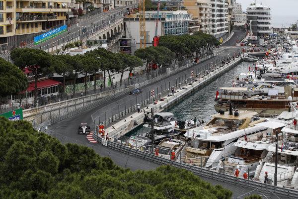 Nikita Mazepin, Haas VF-21, leads Fernando Alonso, Alpine A521