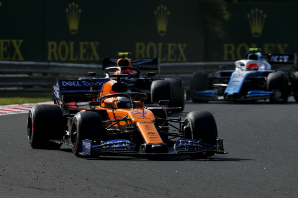 Carlos Sainz Jr., McLaren MCL34, leads Pierre Gasly, Red Bull Racing RB15, and Robert Kubica, Williams FW42