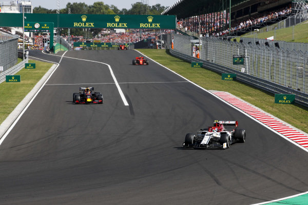 Antonio Giovinazzi, Alfa Romeo Racing C38, leads Max Verstappen, Red Bull Racing RB15, as he leaves the pits ahead of Charles Leclerc, Ferrari SF90, and Sebastian Vettel, Ferrari SF90