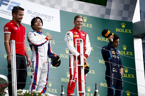 HUNGARORING, HUNGARY - AUGUST 04: Nobuharu Matsushita (JPN, CARLIN), Race winner Mick Schumacher (DEU, PREMA RACING) and Sergio Sette Camara (BRA, DAMS) on the podium during the Hungaroring at Hungaroring on August 04, 2019 in Hungaroring, Hungary. (Photo by Andy Hone / LAT Images / FIA F2 Championship)