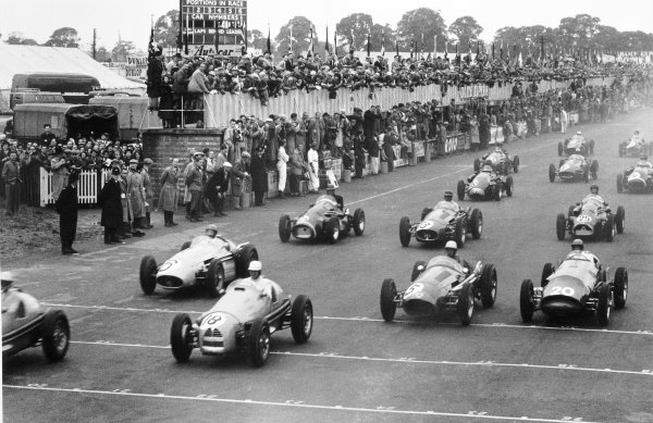 """1954 British Grand Prix Silverstone, Great Britain. 17 July 1954 With the leaders gone Clemar Bucci, Gordini 16 #18, retired, """"B Bira"""", Maserati 250F #6, retired, Roy Salvadori, Maserati 250F #5, retired, and Peter Collins, Vanwall Special #20, retired, take the start. Bill Whitehouse, Connaught A-Lea-Francis, retired, Onofre Marimon, Maserati 250F, 3rd position, and Don Beauman, Connaught A-Lea-Francis, 11th position, follow, action World Copyright: LAT PhotographicRef: Autosport b&w print"""