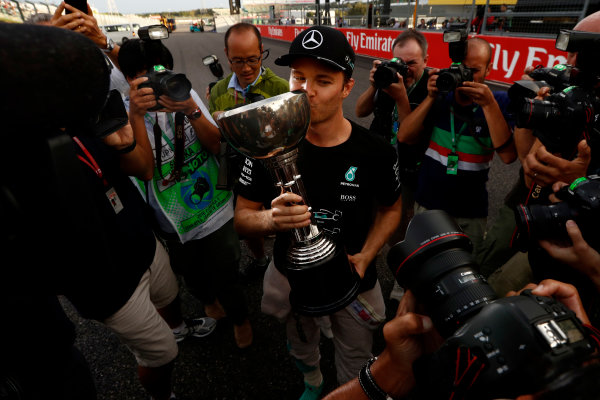 Suzuka Circuit, Japan. Sunday 9 October 2016. Nico Rosberg, Mercedes AMG, 1st Position, celebrates with his trophy. World Copyright: Dunbar/LAT Photographic ref: Digital Image _X4I8897