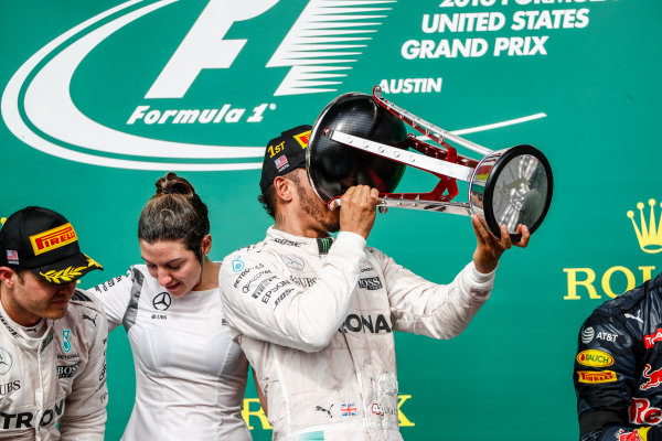 Circuit of the Americas, Austin Texas, USA. Sunday 23 October 2016. Lewis Hamilton, Mercedes AMG, 1st Position, drinks from his trophy. World Copyright: Glenn Dunbar/LAT Photographic ref: Digital Image _31I5245