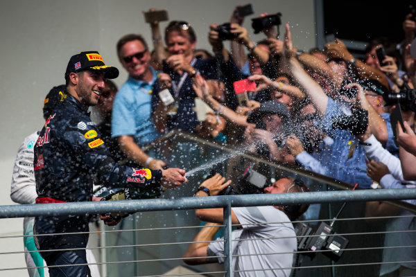 Circuit of the Americas, Austin Texas, USA. Sunday 23 October 2016. Daniel Ricciardo, Red Bull Racing, 3rd Position, sprays Champagne on the podium. World Copyright: Sam Bloxham/LAT Photographic ref: Digital Image _SLA2615_1