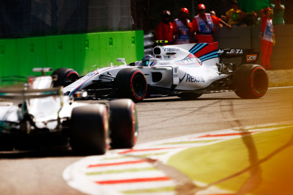 Autodromo Nazionale di Monza, Italy. Friday 01 September 2017. Lewis Hamilton, Mercedes F1 W08 EQ Power+, passes a spinning Lance Stroll, Williams FW40 Mercedes. World Copyright: Andy Hone/LAT Images  ref: Digital Image _ONY5628