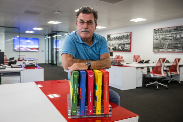 Rainer W. Schlegelmilch poses in the Motorsport Network office in Richmond, United Kingdom