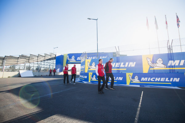 2017/2018 FIA Formula E Championship.Round 3 - Marrakesh ePrix.Circuit International Automobile Moulay El Hassan, Marrakesh, Morocco.Friday 12 January 2018.Allan McNish, Team Principal, Audi Sport Abt Schaeffler, walks Gildo Pallanca Pastor, owner, Venturi Formula E. Michelin logos.Photo: Zak Mauger/LAT/Formula Eref: Digital Image _X0W4427