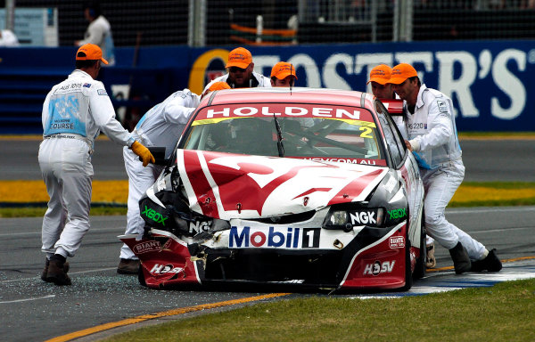 2004 Australian V8 Supercars.Non-Championship Round. Albert Park, Melbourne, 5th - 7th March.Mark Skaife's car is cleared form the track after a first corner crash with Simon Wills in race 3. World Copyright: Mark Horsburgh/LAT Photographicref: Digital Image Only