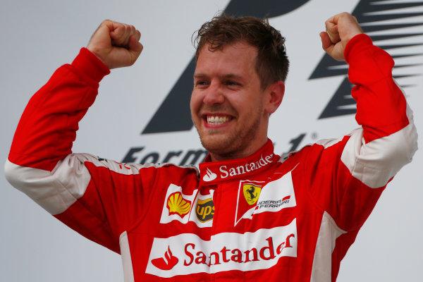 Sepang International Circuit, Sepang, Kuala Lumpur, Malaysia. Sunday 29 March 2015. Sebastian Vettel, Ferrari, 1st Position, celebrates on the podium. World Copyright: Andrew Hone/LAT Photographic. ref: Digital Image _ONZ0489