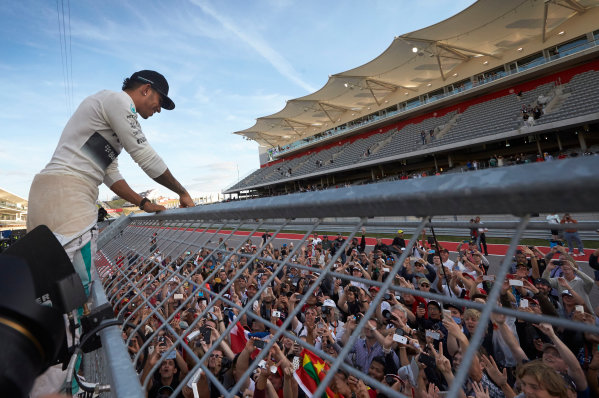 Circuit of the Americas, Austin, Texas, United States of America. Sunday 2 November 2014. Lewis Hamilton, Mercedes AMG celebrates with the fans after winning the race. World Copyright: Steve Etherington/LAT Photographic. ref: Digital Image SNE10581