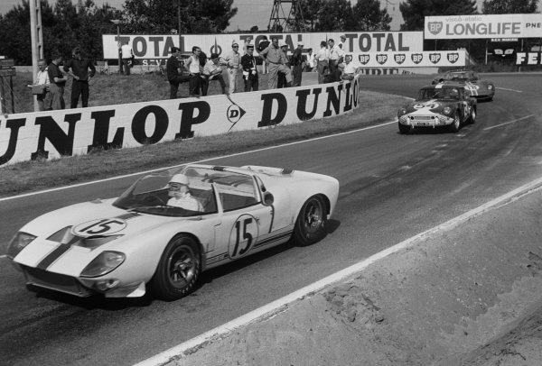 Le Mans, France. 19th - 20th June 1965 Maurice Trintignant/Guy Ligier (Ford GT40 spyder), retired, leads Claude Dubois/Jean-Francois Piot (Triumph Spitfire), 14th position, action. World Copyright: LAT PhotographicRef: 165F - 29.