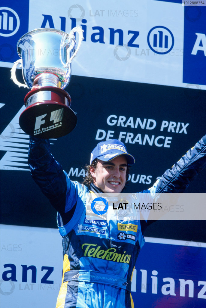 2005 French Grand Prix. Magny-Cours, France. 1st - 3rd July 2005 Fernando Alonso, Renault R25 celebrates his victory on the podium. World Copyright: Lorenzo Bellanca/LAT Photographic Ref: 35mm Image A15