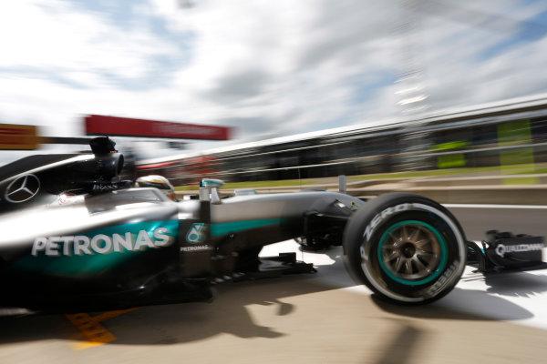 Silverstone, Northamptonshire, UK Friday 08 July 2016. Lewis Hamilton, Mercedes F1 W07 Hybrid, exits his pit garage. World Copyright: Andrew Ferraro/LAT Photographic ref: Digital Image _FER9716