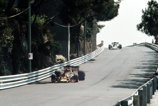 Monte Carlo, Monaco.31/5-3/6 1973.  Emerson Fittipaldi leads Ronnie Peterson (both Lotus 72 Ford's) down towards the Nouvelle Chicane. They finished in 2nd and 3rd positions respectively.  Ref: 73MON36. World Copyright - LAT Photographic