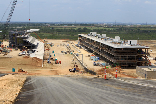 Main straight with Grandstand and Pit and Paddock Buildings. Circuit of the Americas Construction, Austin, Texas, USA, Thursday 14 June 2012.