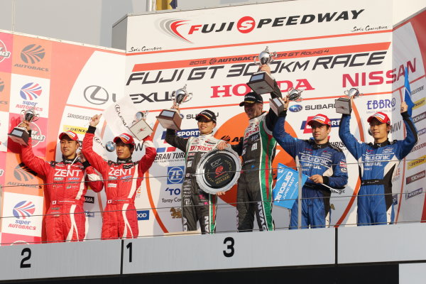 2015 Japanese Super GT Series. Fuji, Japan. 8th - 9th August 2015. Rd 4. GT500 Winner Daiki Sasaki & Michael Krumm ( #24 D'station ADVAN GT-R ) 2nd position Yuji Tachikawa & Hiroaki Ishiura ( #38 ZENT CERUMO RC F ) 3rd position Hironobu Yasuda & J.P.L.De Oliveira ( #12 CALSONIC IMPUL GT-R ) podium, portrait.  World Copyright: Yasushi IshiharaLAT Photographic. Ref: 2015SGT_Rd4_007