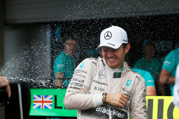 Autodromo Hermanos Rodriguez, Mexico City, Mexico. Sunday 1 November 2015. Nico Rosberg, Mercedes AMG, 1st Position, celebrates victory with his team. World Copyright: Alastair Staley/LAT Photographic ref: Digital Image _79P1867